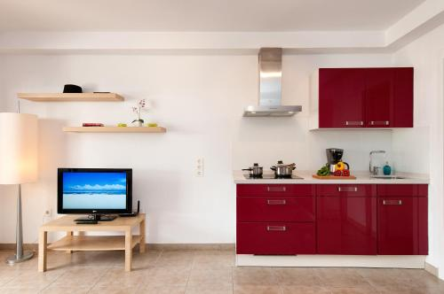 A kitchen or kitchenette at Bungalow Playa del Cura 1