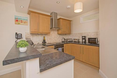 A kitchen or kitchenette at Westbeach Resort