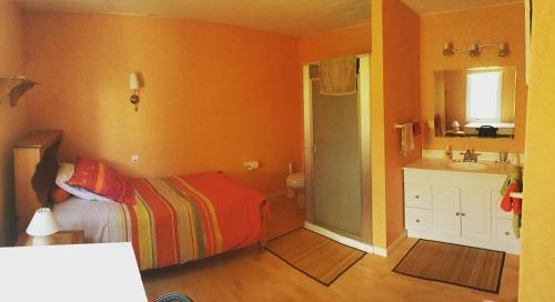 Un ou plusieurs lits dans un hébergement de l'établissement Chez Marie Jo