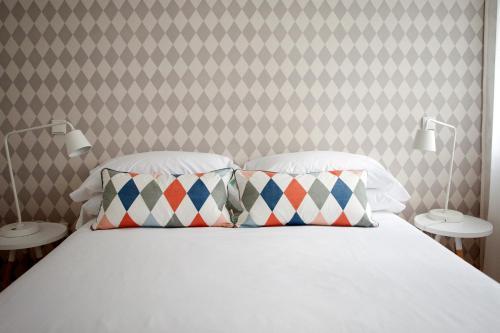 Cama o camas de una habitación en 60 Balconies Urban Stay