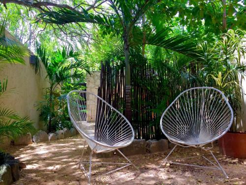 A porch or other outdoor area at Tulum's - 1 & 2 Room APMTs