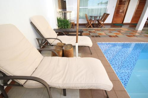 The swimming pool at or near Bluewaves Westcliff Villa