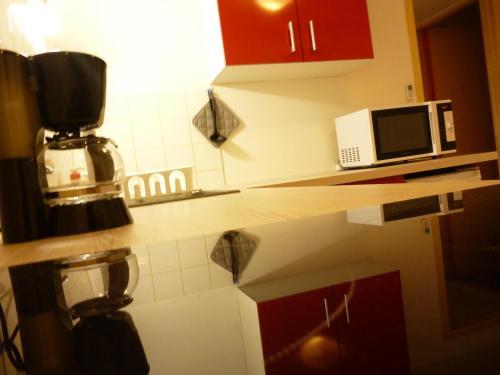A kitchen or kitchenette at Meublé de tourisme Bel être