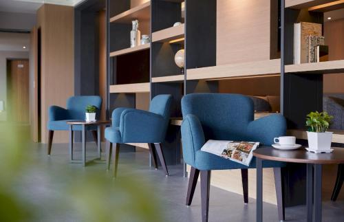 The lounge or bar area at Orange Hotel - Wenhua, Chiayi