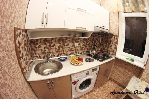 A cozinha ou cozinha compacta de Apartment Bilal