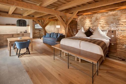Ein Bett oder Betten in einem Zimmer der Unterkunft AlmRefugio