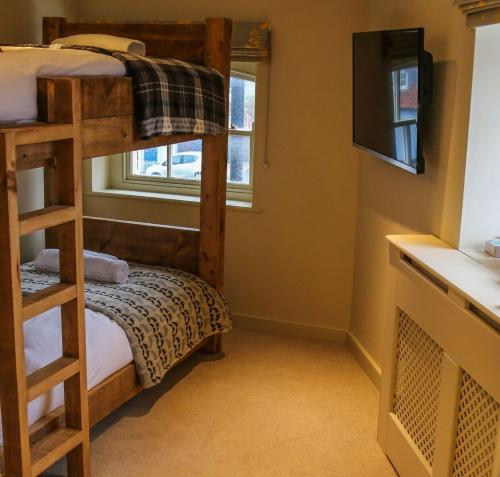 A bunk bed or bunk beds in a room at The Quay Bed & Breakfast