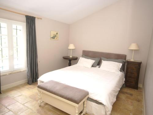 A bed or beds in a room at Modern Villa in Lorgues with Private Pool