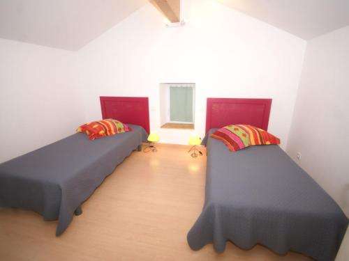 A bed or beds in a room at Cozy Holiday Home in Uzer with Swimming Pool