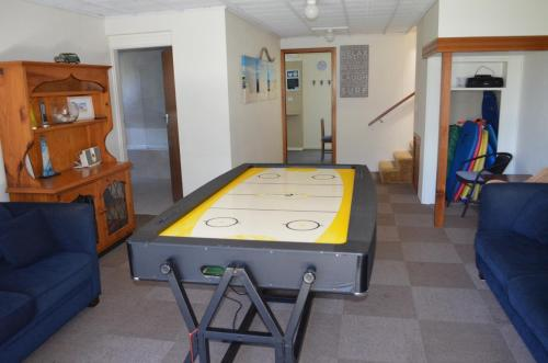 A pool table at Sandy Dunes Beach House
