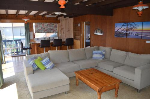A seating area at Sandy Dunes Beach House