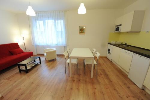 A kitchen or kitchenette at Toldi Apartments Pécs