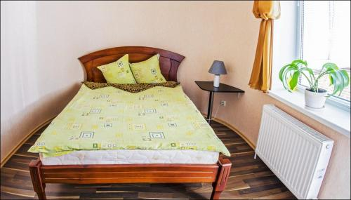 A bed or beds in a room at Hotel Cherkassy