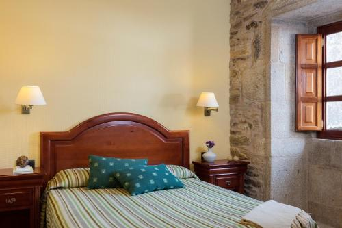 Cama o camas de una habitación en Hotel Rua Villar