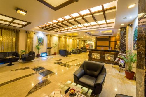 The lobby or reception area at Amantra Comfort Hotel