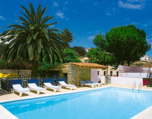 The swimming pool at or near Hotel Praia Dourada