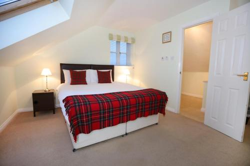 A bed or beds in a room at Hillhead Farm Lets