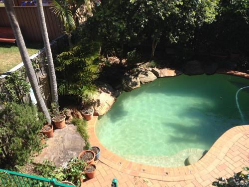 A view of the pool at By The Bay or nearby