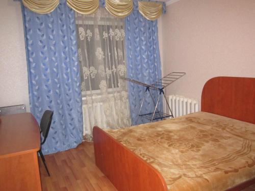 Кровать или кровати в номере Апартаменты на Ленинградской 43