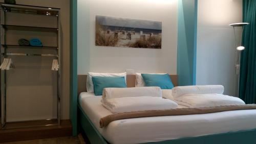 Ein Bett oder Betten in einem Zimmer der Unterkunft B&B Kabine7