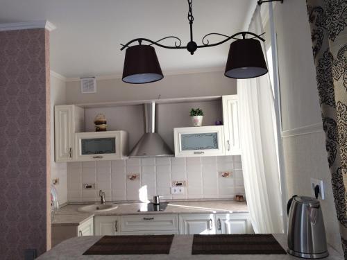 A bathroom at Apartment on Lenina st.56