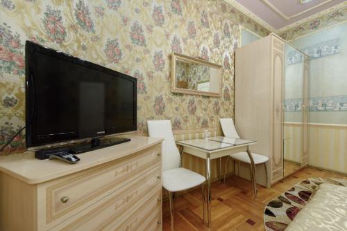Телевизор и/или развлекательный центр в Апартаменты на Рубинштейна 15