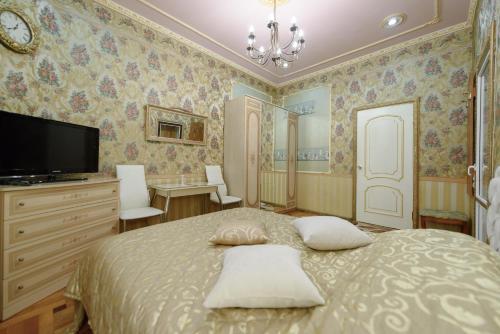 Кровать или кровати в номере Апартаменты на Рубинштейна 15