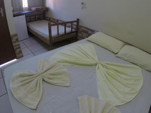 A bed or beds in a room at Pousada Solaris