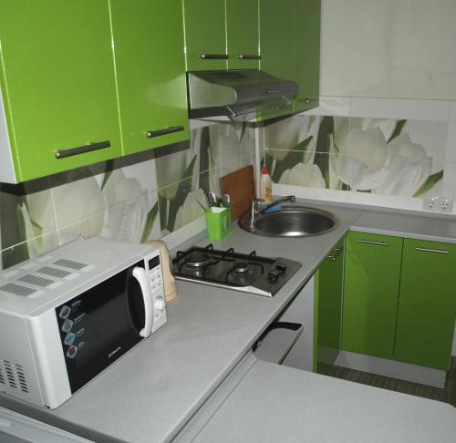 A kitchen or kitchenette at Apartament Sanitarna 17