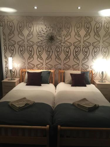 A bed or beds in a room at Breiview Guest House