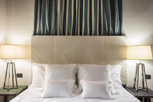 Letto o letti in una camera di Hotel Villa Linneo