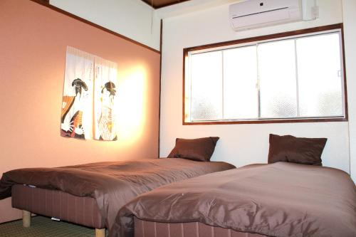 A bed or beds in a room at Funtoco Backpackers Namba