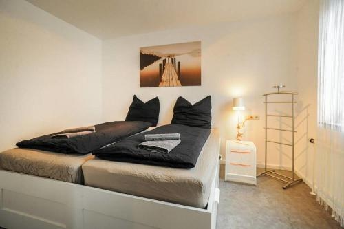 Ein Bett oder Betten in einem Zimmer der Unterkunft Ferienwohnung Metzingen