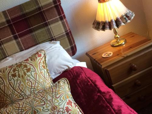 A bed or beds in a room at The Bryntirion Inn
