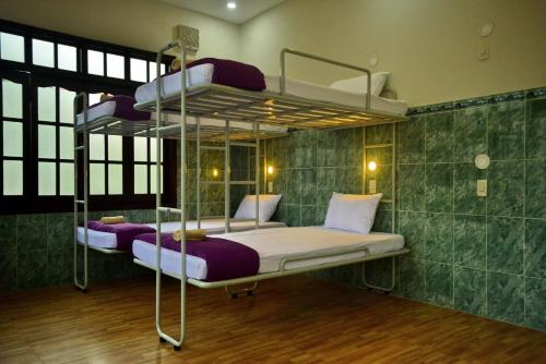 A bunk bed or bunk beds in a room at John & Paul Inn