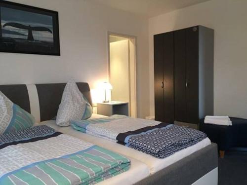 Ein Bett oder Betten in einem Zimmer der Unterkunft Wald Cafe