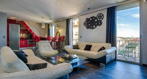 A seating area at RG Duplex - LRA Cannes