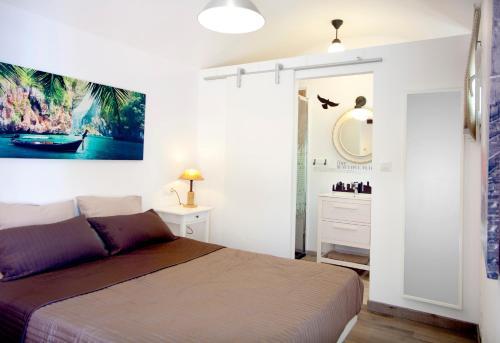 A bed or beds in a room at Alojamiento Vagón Rural