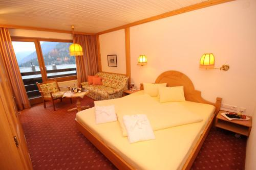 Ein Bett oder Betten in einem Zimmer der Unterkunft Naturhotel Taleu