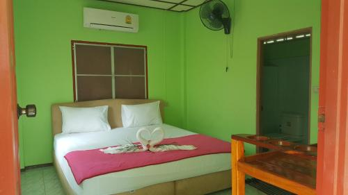 A bed or beds in a room at The Sunflower Bungalows