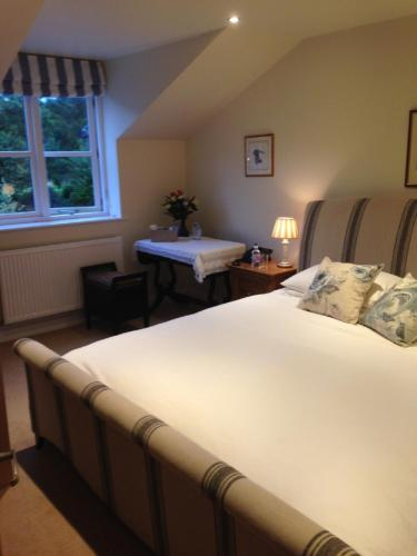 A bed or beds in a room at Mill Cottage