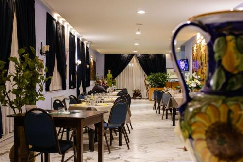 A restaurant or other place to eat at Miramare Hotel