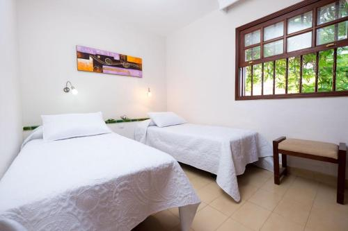 A bed or beds in a room at Sunny Bungalows Parque Golf in Maspalomas