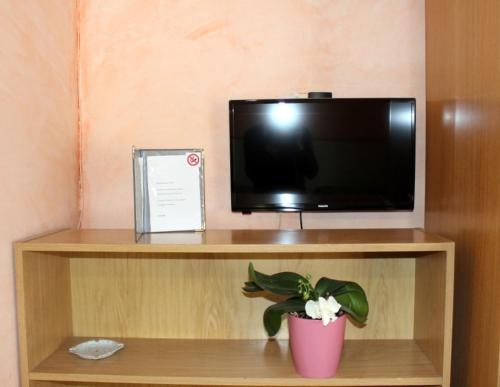 A television and/or entertainment center at Affittacamere La Noce