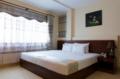 A bed or beds in a room at Beautiful Saigon 3 Hotel