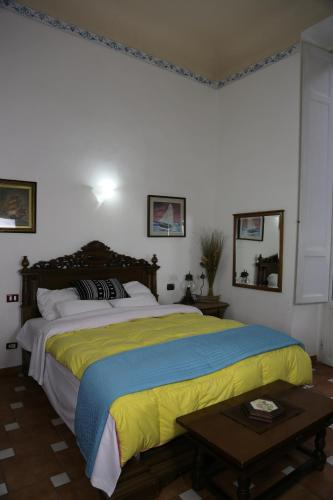 A bed or beds in a room at Tourist House Santa Croce