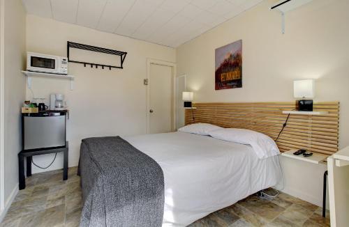 Un ou plusieurs lits dans un hébergement de l'établissement Motel Appartements le Saint-Patrick