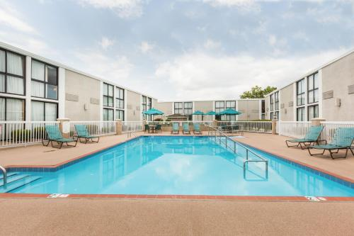 The swimming pool at or near Wyndham Riverfront Hotel