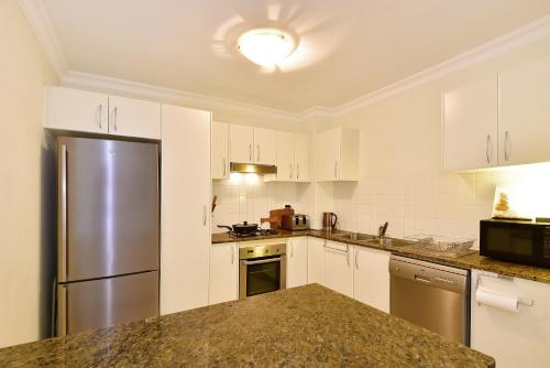 A kitchen or kitchenette at Sorrento 202
