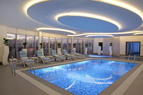 The swimming pool at or near Marriott Executive Apartments Madinah